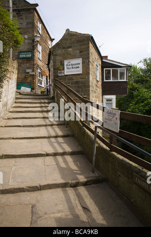 'Chapel Street' and The Old Bakery Tea Rooms in 'Robin Hoods Bay', Yorkshire, England, UK. - Stock Photo