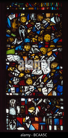 Wells Cathedral window in the Lady chapel with fragments of medieval stained glass showing devils - Stock Photo
