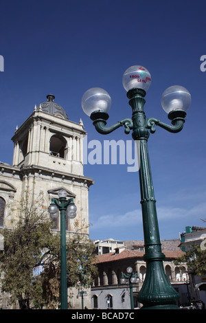 Symbol of 200th anniversary of first declaration of independence in South America on street lamp and cathedral tower, - Stock Photo