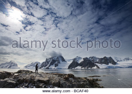 Tourist exploring, Peterman Island, Antarctica - Stock Photo