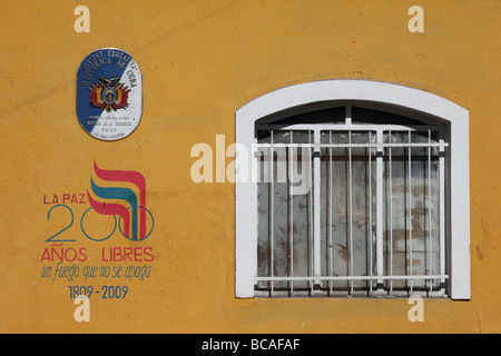 Symbol of 200th anniversary of first declaration of independence in S America on colonial wall , La Paz , Bolivia - Stock Photo