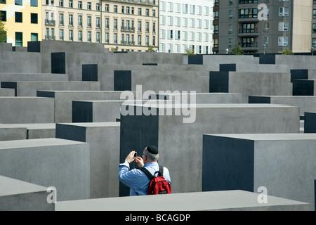 Memorial to the Murdered Jews of Europe - Jewish man photographing - Berlin Germany - Stock Photo
