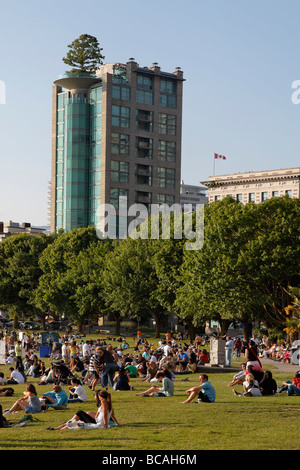 English bay Westend young people relaxing tree on roof top Vancouver City Canada North America - Stock Photo
