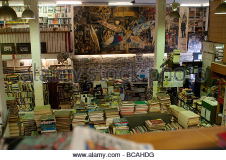 Books in Gould's secondhand bookshop with Diego Rivera poster on King Street, Newtown, Sydney NSW Australia - Stock Photo