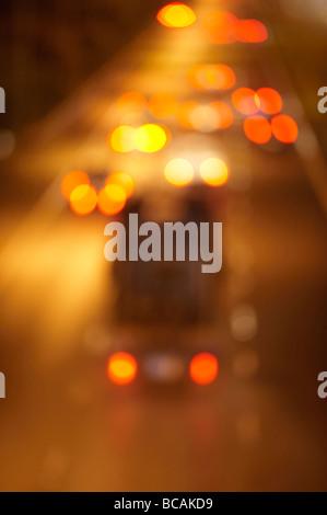 Blurred night freeway traffic - Stock Photo