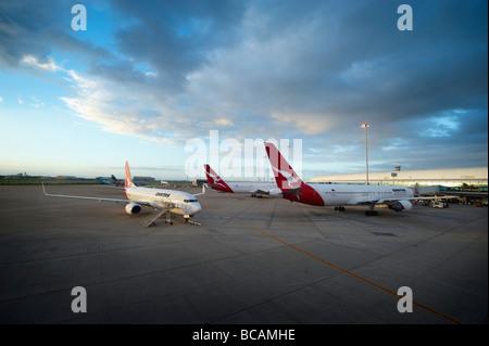 Qantas jets at airport terminal - Stock Photo