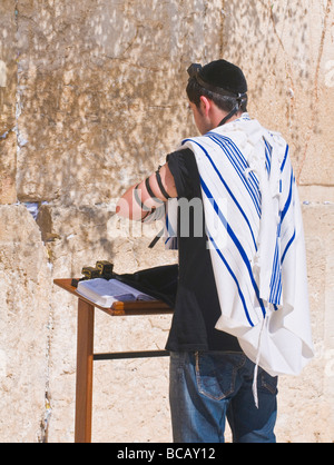A Jew lay tefillin in The western wall in Jerusalem Israel - Stock Photo