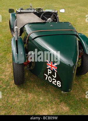 A British racing green Austin Seven Ulster Replica classic sports car. - Stock Photo