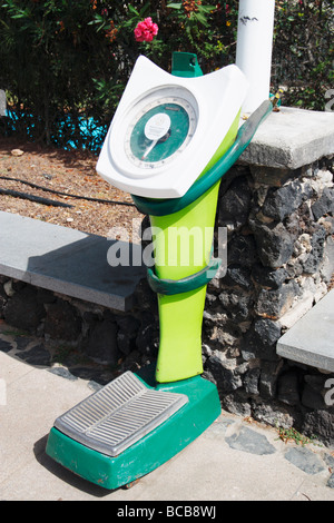 Coin operated scales in street in Spain - Stock Photo