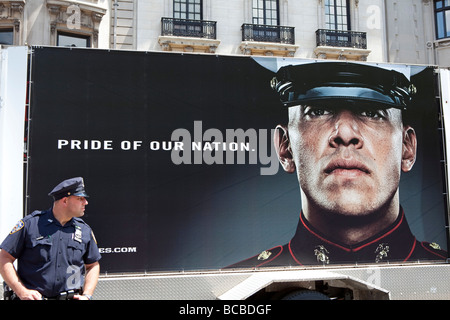 Police officer with a billboard of the USA marines - Stock Photo
