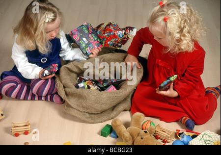 Children with saint Nicholas gifts - Stock Photo