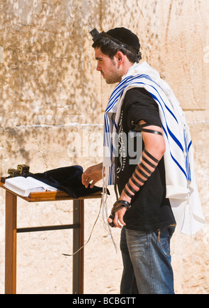 Israel jew lay tefillin in The western wall - Stock Photo