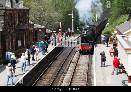 North Yorkshire moors railway steam train arriving at Goathland station (Heartbeat was filmed in Goathland). - Stock Photo