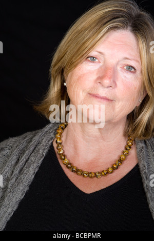 Shot of a Senior Lady Looking Sympathetically - Stock Photo