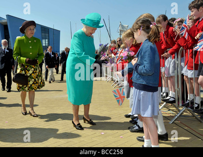 Queen Elizabeth II with school children during her visit to Weymouth and Portland Sailing Academy in Dorset - Stock Photo