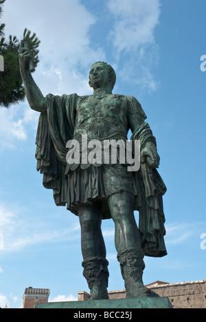 Rome, Italy. Bronze statue of Roman emperor Nerva on the via dei Fori Imperiali. Modern bronze copy of ancient statue - Stock Photo