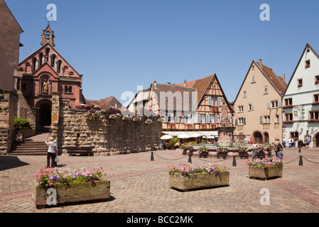 Place du Chateau square in medieval village on the wine route. Eguisheim Haut-Rhin Alsace France. - Stock Photo