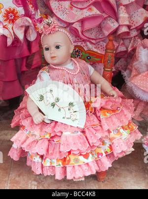 Doll in flamenco dress in shop window Spain - Stock Photo