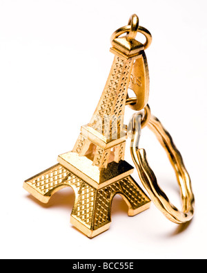 souvenir key chain of mini eiffel tower in gold from paris france - Stock Photo