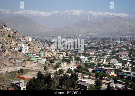 A view of Kabul, Afghanistan, from Koh-e Asmai, popularly called TV mountain, the  snow-covered Koh-i Baba peaks - Stock Photo