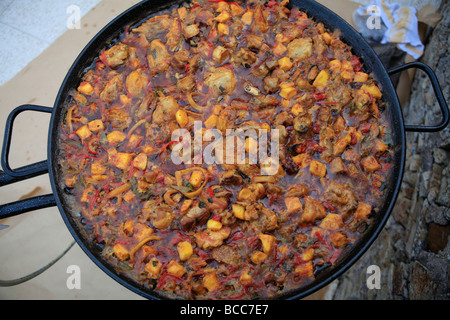 Cooking Paella Spanish Paella probably Spains most colourful and famous gastronomic delight. Spanish food. - Stock Photo