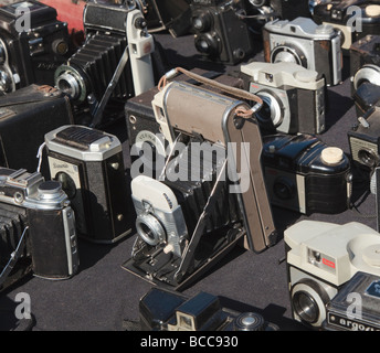 Selection of collectible cameras laid out at a boot sale - Stock Photo