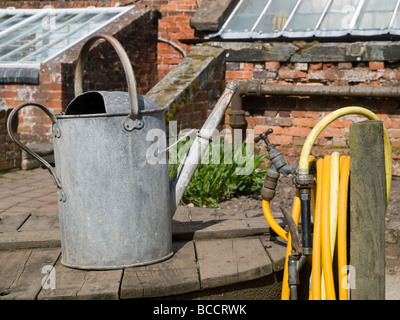 Marvelous Old Garden Tap With Plastic Hose Pipe Attachment And Hosepipe  With Foxy  An Old Metal Watering Can And Garden Hose England Uk  Stock Photo With Captivating Milton Garden Center Also In The Night Garden Tune In Addition Rooftop Gardens In London And Garden Furniture Uk Online As Well As Gardener In Reading Additionally Garden Peat For Sale From Alamycom With   Foxy Old Garden Tap With Plastic Hose Pipe Attachment And Hosepipe  With Captivating  An Old Metal Watering Can And Garden Hose England Uk  Stock Photo And Marvelous Milton Garden Center Also In The Night Garden Tune In Addition Rooftop Gardens In London From Alamycom