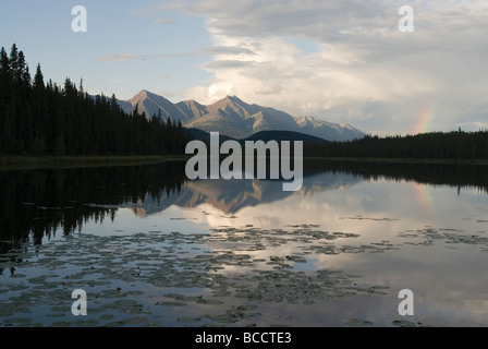 Reflection of Bonanza Ridge in Crytal Lake on the McCarthy Road. - Stock Photo