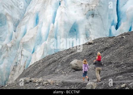 Family hiking to Exit Glacier in Kenai Fjords National Park, Alaska. - Stock Photo