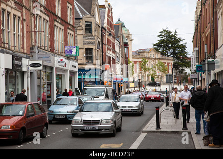Traffic in one way street in town centre Barry Wales UK - Stock Photo