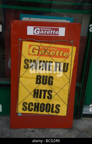 Swine Flu in London Newspaper headlines saying Swine flu bug hits schools - Stock Photo