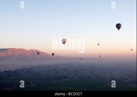 [Hot air balloons] flying high over 'West Bank' at sunrise, Luxor, Egypt - Stock Photo