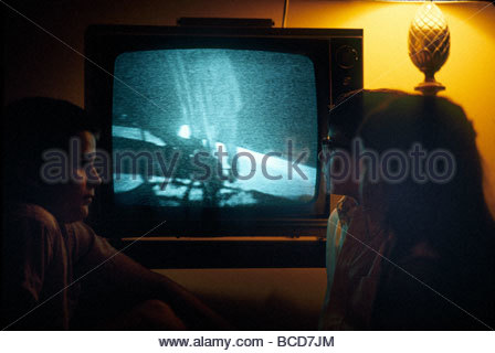 Kids watch as Neil Armstrong steps onto the moon on July 16, 1969. - Stock Photo