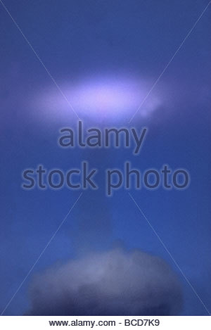 Apollo 11 disappears into a cloud during launch on July 16, 1969. - Stock Photo