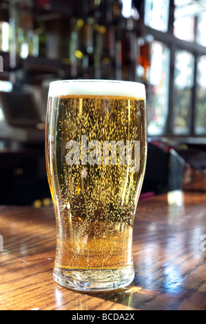Close up of a pint of lager in a pub, England, UK - Stock Photo