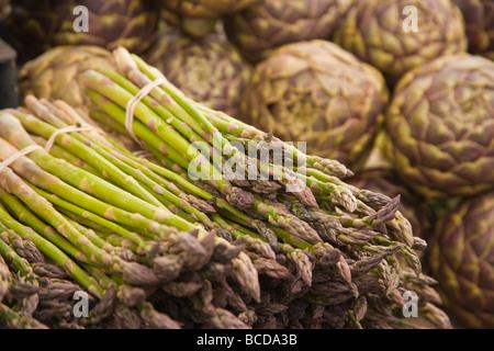 asparagus and artichokes Farmers Market Santa Barbara California United States of America - Stock Photo