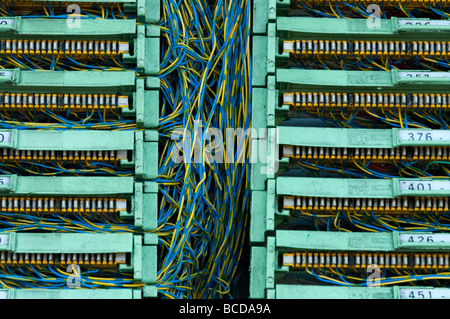 Tangle of telecommunications wires inside phone junction box, UK - Stock Photo