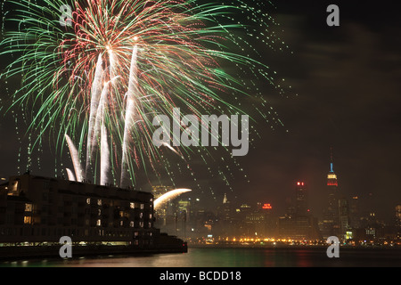 The annual Macy's Fourth of July fireworks extravaganza lights the sky over the Hudson river on July 4, 2009. - Stock Photo
