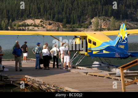 People preparing to board float plane at Green Lake in Whistler, British Columbia, Canada - Stock Photo