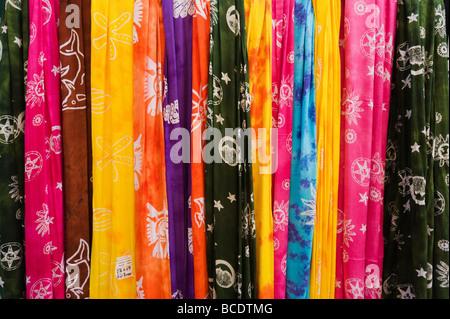 Brightly coloured cloth for sale in Rethymnon, North West Coast, Crete, Greece - Stock Photo