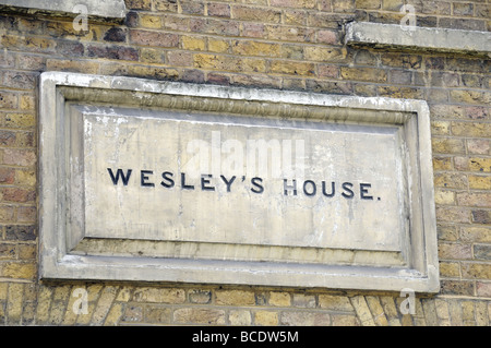 Stone in wall with Wesley's House written on it City Road London England UK - Stock Photo