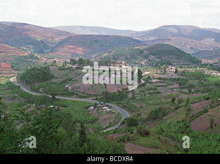 Mountain road climbing towards Rwanda from Kabale in south west Uganda East Africa - Stock Photo