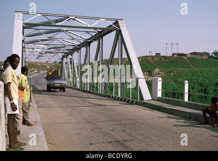 Bridge over Kazinga Channel near Lake George Uganda East Africa Toyota pickup loaded with furniture crossing - Stock Photo