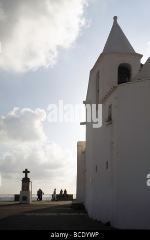 Into the evening light the Church of Soccorso (Chiesa del Soccorso) small whitewashed church in Forio. A Church - Stock Photo