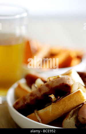 Freshly Cooked Pork Sausage Hot Dogs With Onions In A White Bread Crusty Roll Served In A Dish With No People - Stock Photo