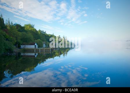 Misty morning on Lake Windermere, Lake District National Park, Cumbria, England UK - Stock Photo