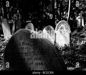 Headstones in Highgate Cemetery, London - Stock Photo