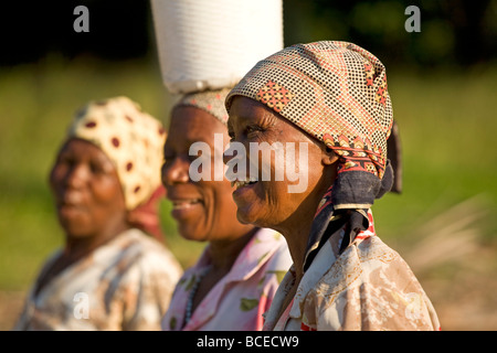 Mozambique, Inhaca Island. African ladies on the Island of Inhaca in Mocambique laugh together in the evening sun. - Stock Photo