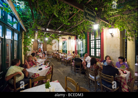 Traditional taverna at night in the old town, Rethymnon, Crete, Greece - Stock Photo