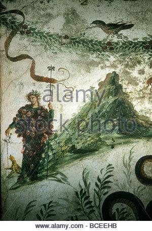 Bacchus, Roman god of wine, stands before Vesuvius in ancient fresco. - Stock Photo